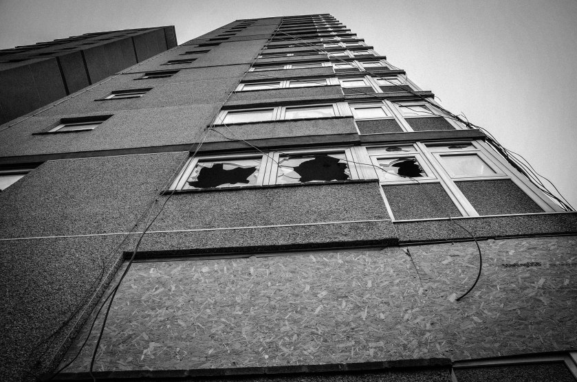 The buildings take on a new sadness with broken windows.